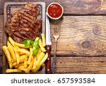 grilled meat with french fries... | Shutterstock . vector #657593584