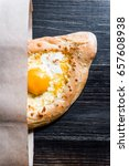 Small photo of Khachapuri in Adzharian with Adyghe cheese, cheese and yolk. Traditional Caucasian food