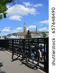 Stock photo bicycle parked next to limmat river zurich switzerland 657648490