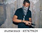 black gang member checks his...   Shutterstock . vector #657679624
