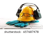 yellow hard hat with headphones ... | Shutterstock . vector #657687478