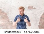 portrait of young man making... | Shutterstock . vector #657690088