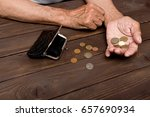 An Elderly Person Holds The...