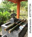 Small photo of Temizuya, Shinto water ablution pavilion in Japan, at Kumano Nachi Taisha