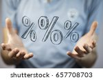 man  holding  percents icon in... | Shutterstock . vector #657708703