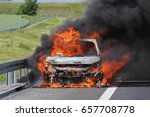 a car burning on a highway with ... | Shutterstock . vector #657708778