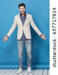 happy handsome man over blue... | Shutterstock . vector #657717814
