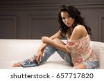young lifestyle woman on couch  | Shutterstock . vector #657717820