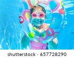 little girl swimming in pool | Shutterstock . vector #657728290