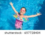 funny little girl swims in a... | Shutterstock . vector #657728404