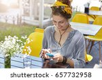 woman wearing sunglasses and... | Shutterstock . vector #657732958