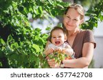 Mother and Baby Daughter Outdoors In Summer - stock photo