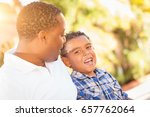 mixed race son and african... | Shutterstock . vector #657762064