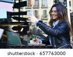 cheerful attractive female... | Shutterstock . vector #657763000