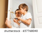 young father helping his son to ... | Shutterstock . vector #657768040