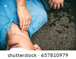 Small photo of Unconscious, Pulse Checking Carotid Artery on a Man who has Senseless, One Part of the Resuscitation (First Aid)