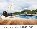 wood table top on beach chair... | Shutterstock . vector #657811000