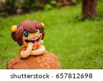 Clay Doll In The Garden