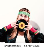 woman with a vinyl record in...   Shutterstock . vector #657849238