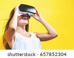 happy young woman using a...   Shutterstock . vector #657852304