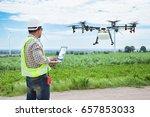 technician farmer use wifi... | Shutterstock . vector #657853033