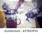 hands of architect drawing... | Shutterstock . vector #657853954