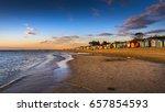 city beach bathing boxes sunset ... | Shutterstock . vector #657854593