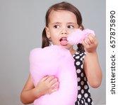llittle girl eating cotton... | Shutterstock . vector #657875890
