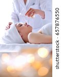 young woman lying on a massage... | Shutterstock . vector #657876550