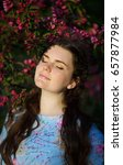 Small photo of Girl's portrait blindly in the blossoming apple-tree with claret flowers