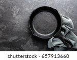 empty cast iron frying pan on... | Shutterstock . vector #657913660