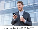 business man looking at phone... | Shutterstock . vector #657916870