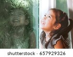 happy asian little girl looking ... | Shutterstock . vector #657929326