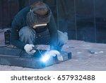 the welder cooks the frame. the ... | Shutterstock . vector #657932488