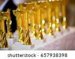 gold medals cups are on the... | Shutterstock . vector #657938398