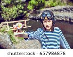 happy child playing pilot... | Shutterstock . vector #657986878