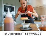 blogger taking picture of cake... | Shutterstock . vector #657990178