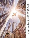 plane flying over highrise... | Shutterstock . vector #657995644