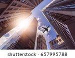 plane flying over multiple... | Shutterstock . vector #657995788