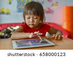girl is playing tablet to find... | Shutterstock . vector #658000123
