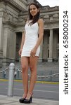 Small photo of Tall Latina Person Wearing A White Dress