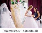 female trying on wedding dress... | Shutterstock . vector #658008850