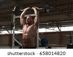 athlete in the gym performing... | Shutterstock . vector #658014820