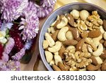 assorted nuts in the bowl  next ... | Shutterstock . vector #658018030