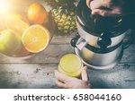 man preparing fresh orange... | Shutterstock . vector #658044160