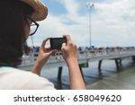 tourist woman taking sea photo... | Shutterstock . vector #658049620