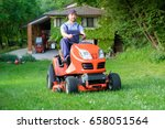 gardener driving a riding lawn... | Shutterstock . vector #658051564