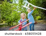 children play on the street by... | Shutterstock . vector #658055428