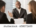 employer showing thumbs up to... | Shutterstock . vector #658072600