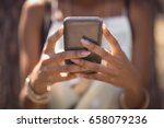 midsection of woman using smart ...   Shutterstock . vector #658079236